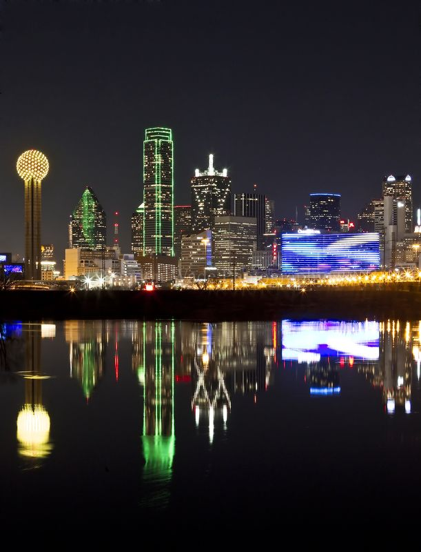 Downtown Dallas skyline reflected in the swollen Trinity River at night. Photo by Brandon Wade