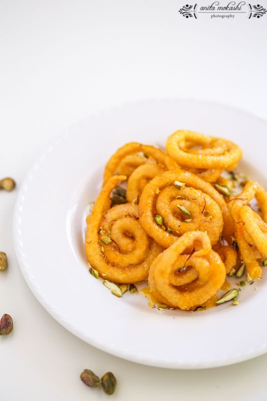 Jalebi, or Jilapi, or Jilawii (and sometimes Zulbia) is a sweet popular in countries of the Indian Subcontinent. It is made by deep-frying a maida flour batter in pretzel or circular shapes, which ...