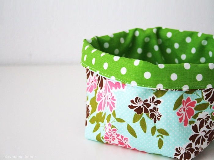 Here's another great tutorial from Lu of the blog Luloveshandmade. Here, she shows us how to sew a great little fabric basket. It's great for storing remote controllers, phones and tiny gadgets on a TV table or small toys and odds and ends. It can even make a great bread basket for your breakfast table. Best