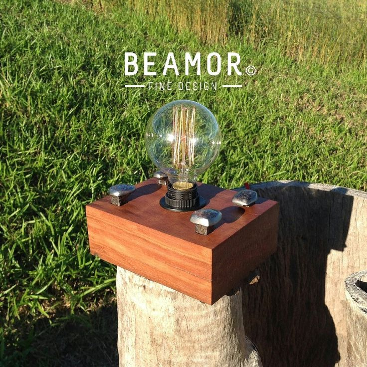 Four rail pins have been added as a feature to this sleeper lamp. Add an Edison style bulb, and you have a great addition to your decor. #interiordesign #lighting #edisonbuld #upcycle #etsystore #beamorfinedesign
