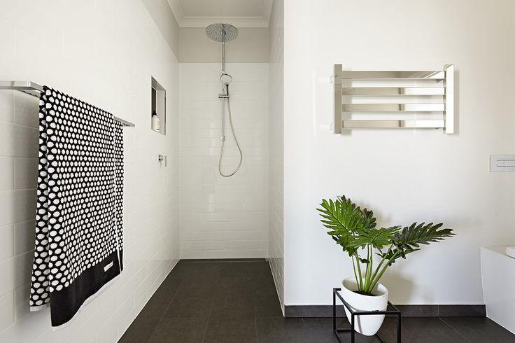 White #subwaytile, Twin head shower @ReeceBathrooms, heated towel rail, recessed tile shower shelf.