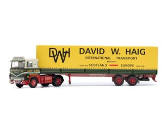 This Scania 141 Tilt Trailer Diecast Model Lorry is Yellow and features working wheels. It is made by Corgi and is 1:50 scale (approx. 30cm / 11.8in long).    In 1946, David Wilkie Haig acquired an ex-war department Thornycroft lorry after returning to his home town of Bellshill and decided to set up a transport business.  With the British economy struggling to recover from six years of war David was swamped with an increasing amount of customers and workload which would soon lead to the…