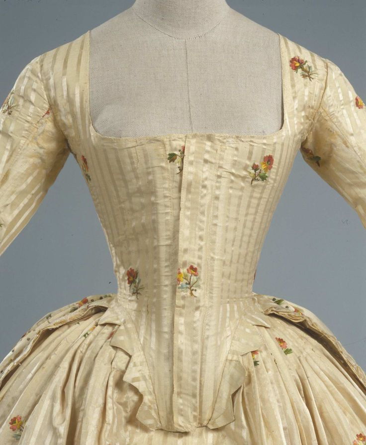 Detail front view, robe à l'anglaise, Italy, ca. 1780.  Ivory striped silk pékin, embroidered with floral sprays and floral branches in polychrome silk thread.