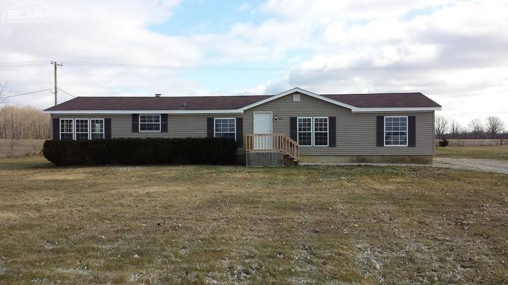 Updated manufacture ranch style home with new carpet and baseboard heating.  Very clean and move in ready on over 1acre parcel.  Great location in Swartz Creek schools.