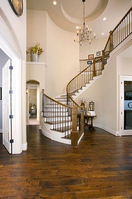 Large open entryway curved staircase small table perfect for Furniture for curved wall in foyer