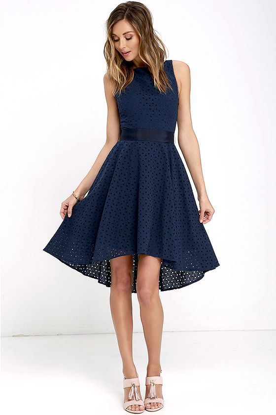 For brunch, that upcoming wedding, or Sunday afternoon stroll, the BB Dakota Lilyana Navy Blue Embroidered High-Low Dress is all you'll ever need! Lightweight cotton (with pierced embroidery) travels from a bateau neckline and sleeveless, darted bodice, to a fitted waist with tying grosgrain ribbon sash. Midi skirt has a flattering high-low hem. Hidden back zipper/clasp.