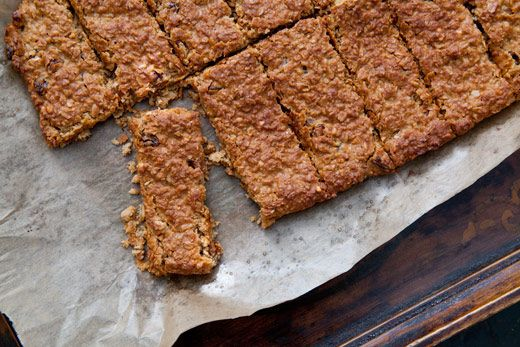 Homemade granola bars with peanut butter, honey, oats, and golden raisins.