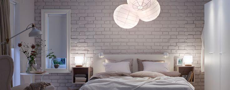 Comfortably lit cozy white bedroom.