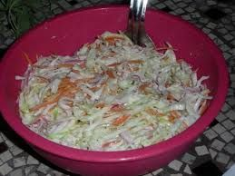Popeye's Restaurant Copycat Recipes: Coleslaw (by the lady who has a sister who wrote the manual for Popeyes and she remembers making the cole slaw-Very very simple recipe-Finely cut up cabbages and carrots, Sugar (she said lots and that is what I did), Mayonnaise (use Best Foods, which is Hellmans' back East), Sweet pickle relish and  some dill pickle relish. No vinegar, no onion, add salt to taste and celery seed. Amazing.  Who knew?)  (www.ChefBrandy.com)