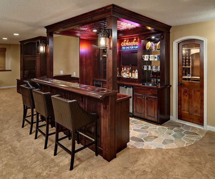 Chic Wooden Basement Bar Idea With Square Shaped Bar And Antique Wall Light  And Racks