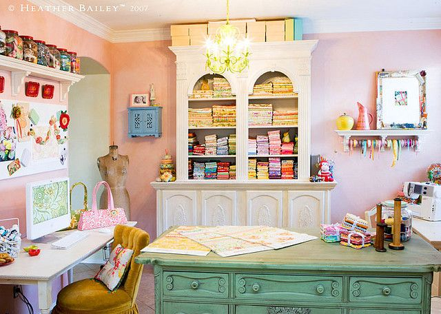 """Craft room, yes please!  I am a """"fabric-aholic"""" and I like how the fabric (probably quilt quarters) are folded and displayed.  I love to display my fabrics, especially the vintage ones."""