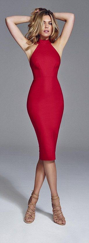Abbey Clancy models her new Seventies-inspired party wear collection #dailymail