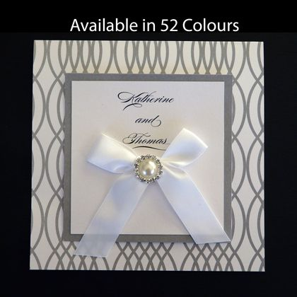 Elegant Wedding Invite. These square folding wedding invitations have the wedding celebration details printed on the inside. There is a tied bow and pearl and diamante embellishment on the front. www.kardella.com