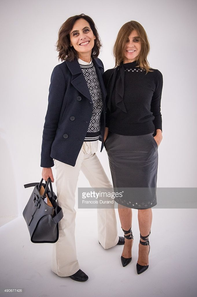 Ines de la Fressange and Carine Roitfeld attend the Carine Roitfeld Collection For Uniqlo : Presentation as part of the Paris Fashion Week Womenswear Spring/Summer 2016 on September 30, 2015 in Paris, France.