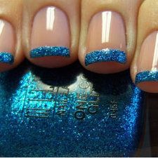Blue Glittered Tips Manicure