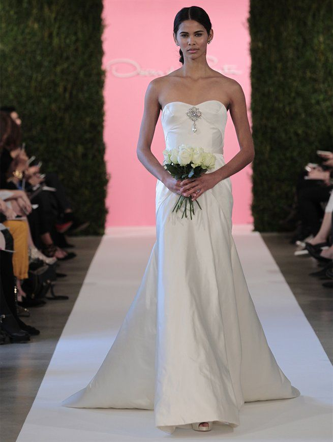 Spectacular Wedding dresses from Oscar de la Renta Ivory duchess satin trumpet gown crystal and pearl earring crystal and white pearl bow brooch ivory satin Desi