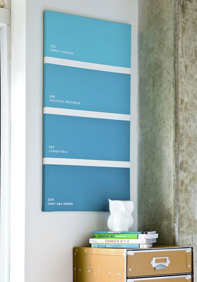 Make a decorative paint chip canvas.  Perfect for over our bed and inexpensive enough to change out when I want a new pop of color!