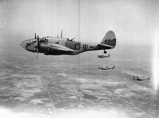 A section of Martin Baltimore Mark IIs (AG781 'B' nearest) of No. 55 Squadron RAF operating from landing grounds in the Western Desert, in flight on a bombing sortie during the Alamein offensive.