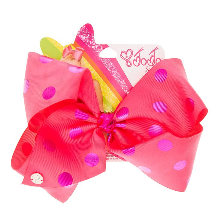 <P>Add a pretty finishing touch to your hair style this season with this large bright pink hair bow from the JoJo Siwa collection. This fun hair bow in pink features an all over purple polka dot print. Simply clip the bow into your pony tail to instantly transform your look and give you real JoJo Siwa style!</P><UL><LI>JoJo Siwa collection <LI>Large pink & purple bow <LI>Polka dot print <LI&...