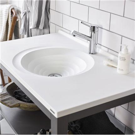 Art, en badrumsserie från Vedum Kök och Bad med spiralformat tvättställ. Läs mer hos Byggkatalogen!