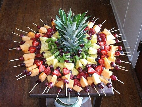 fruit kabobs. great ideas for parties and a great idea for graduation open houses( use a watermelon and make a turkey face and use these stuck in as feathers...maybe)