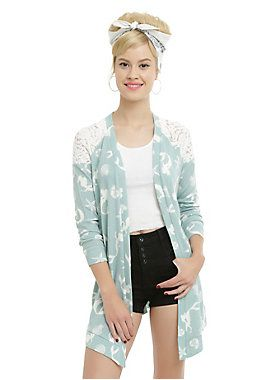 <p>Sometimes, even mermaids get chilly. Warm up in style in this flyaway cardigan from Disney's <i>The Little Mermaid. </i>The seafoam cardigan has an ivorylace raglan sleeve and back panel and ivory allover Ariel and shell print. The perfect sweater for those cool summer nights at the beach.</p>  <ul> <li>94% polyester; 6% spandex</li> <li>Hand wash cold; dry flat</li> <li>Imported</li> <li>Listed in junior sizes</li> </ul>