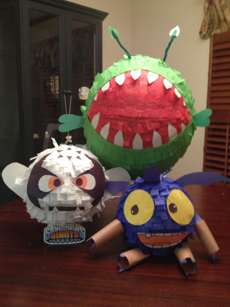 Skylanders party! Chompy piñata, kaos and pop fizz decorations. Used balloons and paper mâché (newspaper strips dipped in flour/water). Bought tissue paper and cut into strips to cover the paper mâché, then construction paper for eyes, ears and arms. Very cheap to make!