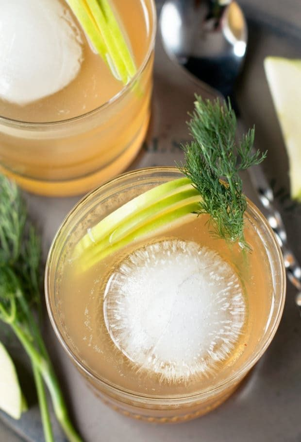 Craving a cocktail with a little extra depth this week? A Whiskey Apple Ginger Fizz always does the trick! The smooth and tart combination of whiskey, apple juice and ginger beer will tickle your taste buds, but it's the surprise ingredient of dill that'll have everyone begging for a second round. Whiskey Apple Ginger Fizz http://www.cakenknife.com/whiskey-apple-ginger-fizz/ | cakenknife.com #cocktail #happyhour