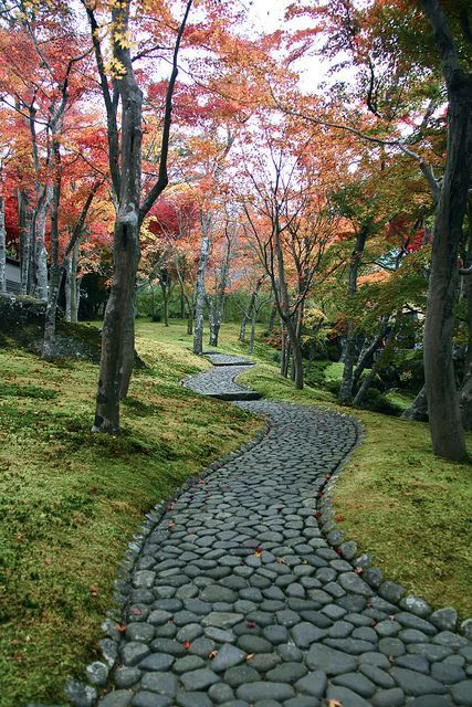 Stone Garden Path Ideas this flagstone path uses pebbles to fill in the gaps between stones 32 Natural And Creative Stone Garden Path Ideas Gardenoholic Gardenoholic
