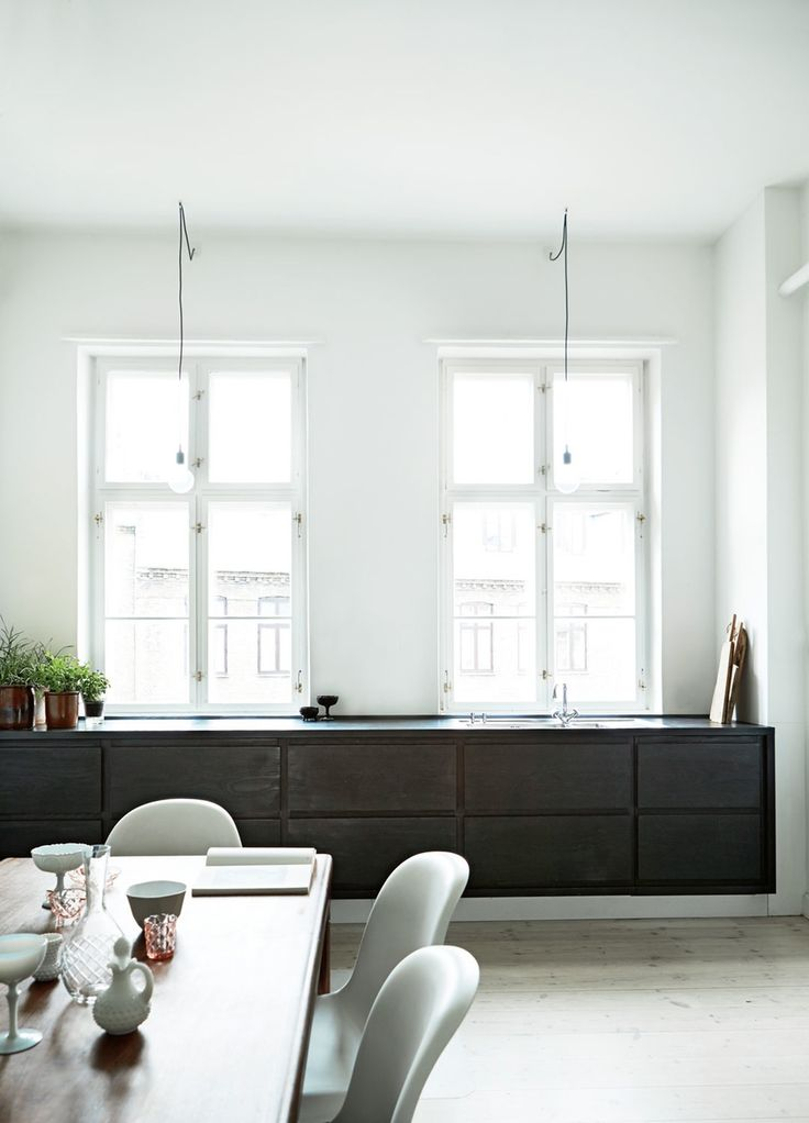 dark kitchen cabinets in a spacious Copenhagen apartment