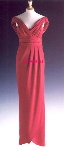 Designed by Victor Edelstein, lot #30 is this fuchsia pink silk off-the-shoulder gown. The Princess wore this on several occasions. It raised $ 36,800 for Diana's charities. Diana first wore it in November 1990 on a visit to Japan. She also wore it for a 'Help The Hospice' banquet in 1990. Again in 1990 she wore it to a charity dinner in the United States. Sometimes she wore a brooch at the 'V' of the bodice. She was seen in this gown again at the premiere of 'Just Like A Woman' in 1992.