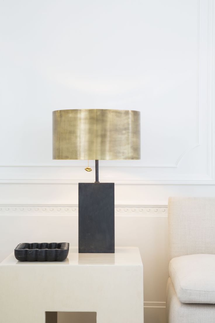 KELLY WEARSTLER   ZUMA TABLE LAMP. Mixed metals of bronze and antique burnished bronze, accented by Kelly's signature kiss motif in a thoughtful pull chain.