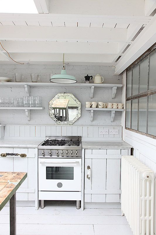 Beautiful beach house situated behind dunes of Camber Sands Open plan kitchen/dining/living space Kitchen with island and ...