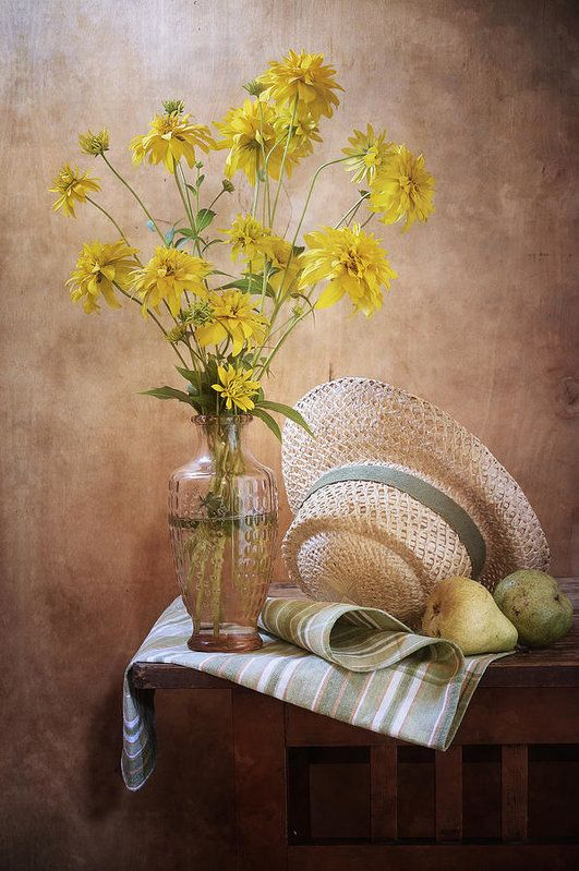 http://nikolay-panov.pixels.com/products/goldenglow-flowers-nikolay-panov-art-print.html • Floral still life photography with bouquet of yellow goldenglow flowers in vintage vase, straw hat and green pears on wooden table in summer