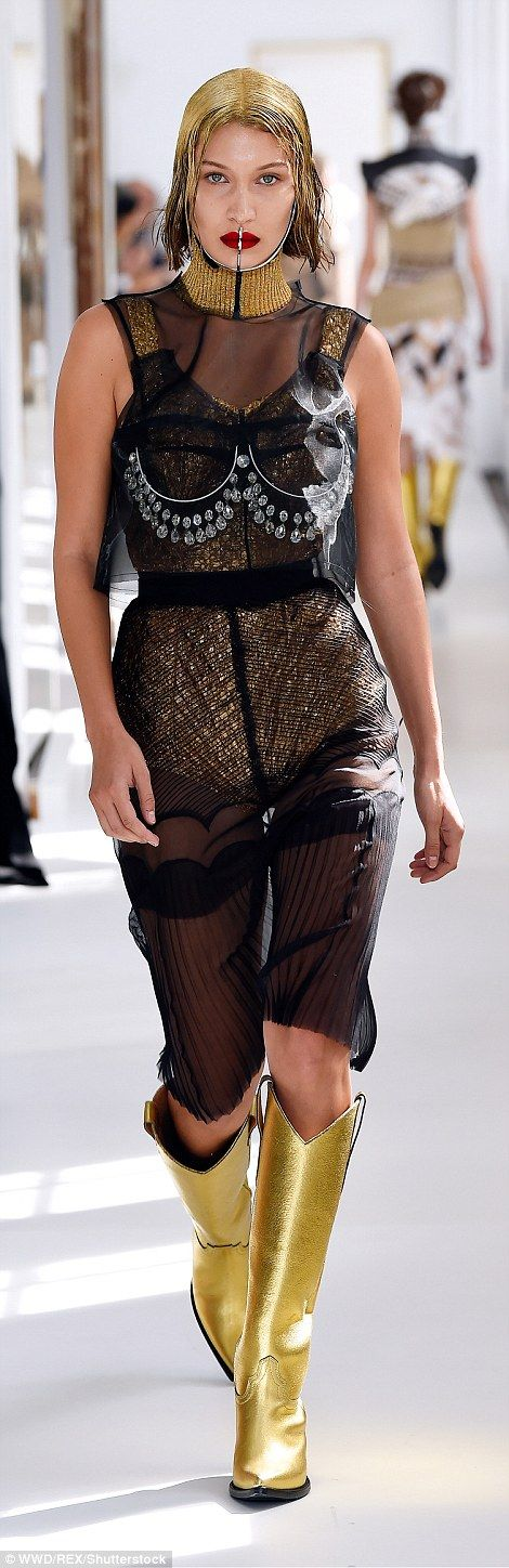 Futuristic fashion:Bella Hadid established herself as a true darling of the high fashion world as she stomped down the runway for the Maison Margiela AW17 show during Haute Couture Fashion Week in Paris on Wednesday