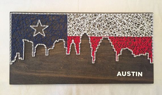 Custom 12 x 24 inch Skyline String Art - with or without wooden lettering Not your city? No problem - just let us know what city you would like.  Please indicate choices for: - stain color - string color(s) - font (if applicable)  Possibilities are endless, please feel free to contact us to help create the perfect item for you. Dont see the perfect color, send us a message, we might be able to help!  Items pictured: - Skyline Fill - Ebony stain, Texas Flag in Navy, White, and Red hemp…