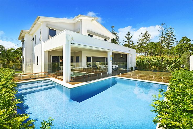 A true family #home, featuring two master suites, large open plan living areas, superb alfresco #dining and #entertaining poolside, along with a large timber jetty to moor your boat. 39 Allambi Ave | Gold Coast / Hinterland | #Australia | Luxury Property Selection