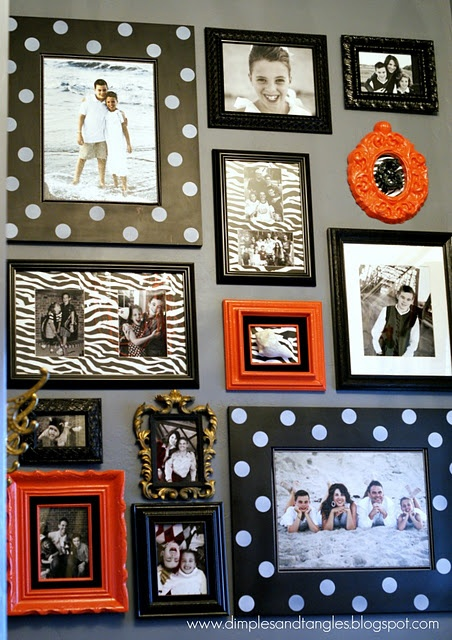 Love! I want to buy a bunch of cheap frames from a thrift store and paint them all to match! So cute