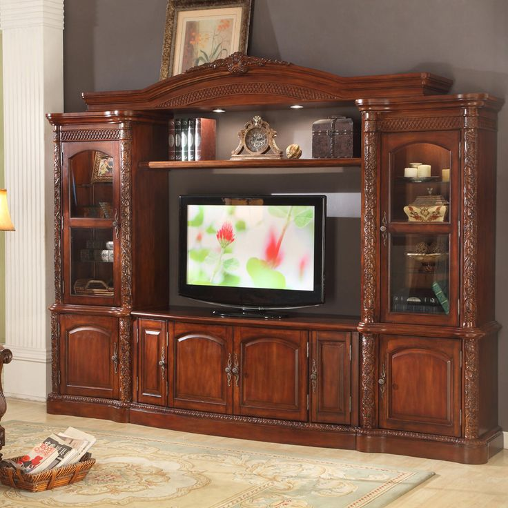 Update Your Living Space With This Grand Entertainment Set Featuring A Durable Hardwood And Fiberglass Construction In Rich Brown Finish