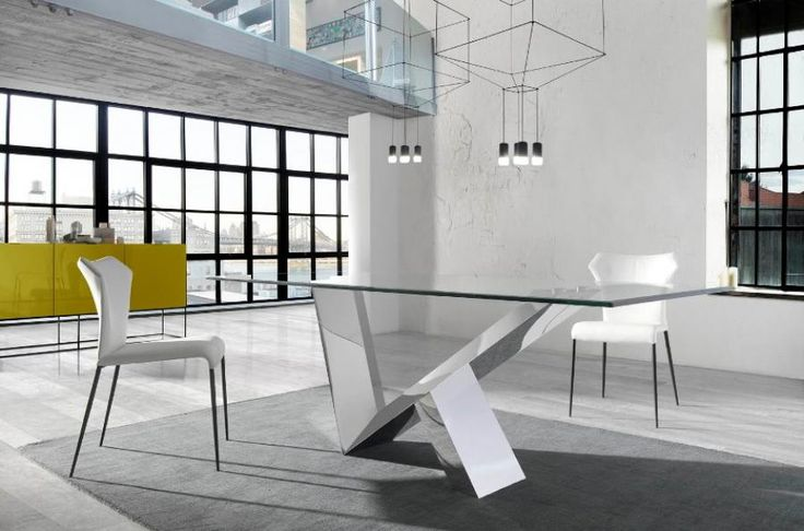 Modern And Stylish Dining Table With A Steel Base And Top