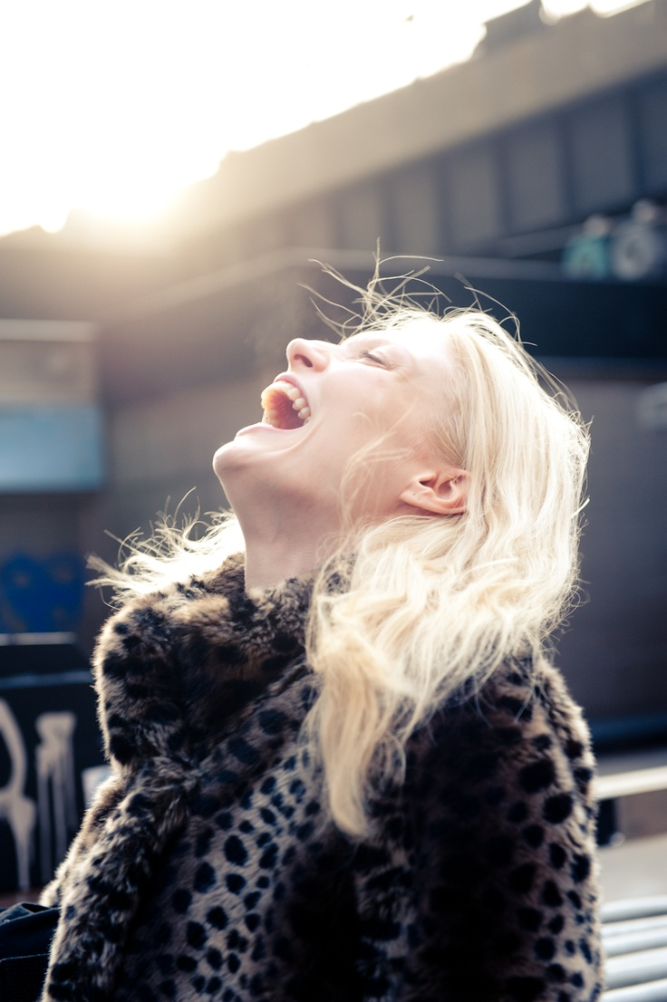 laughter is a girl's best friend and her leopard coat is a close second...