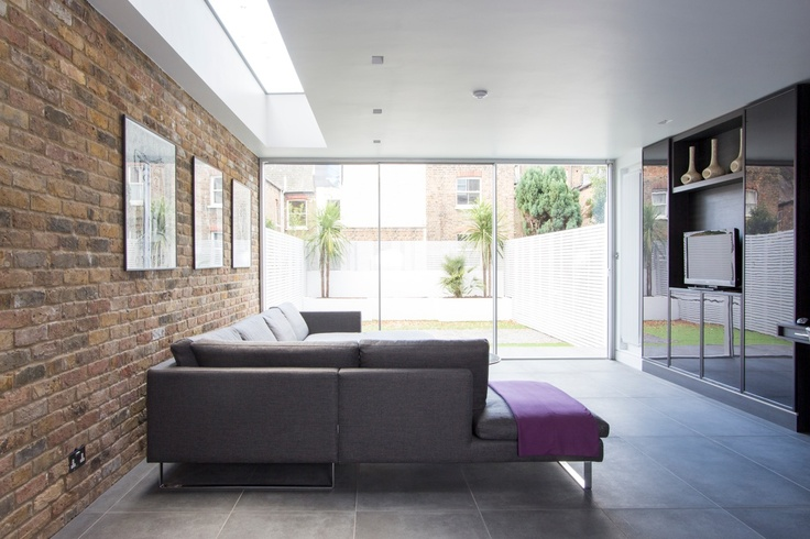 Minimal Windows Sliding Doors with frameless rooflight above on residential refurb by IQ Glass