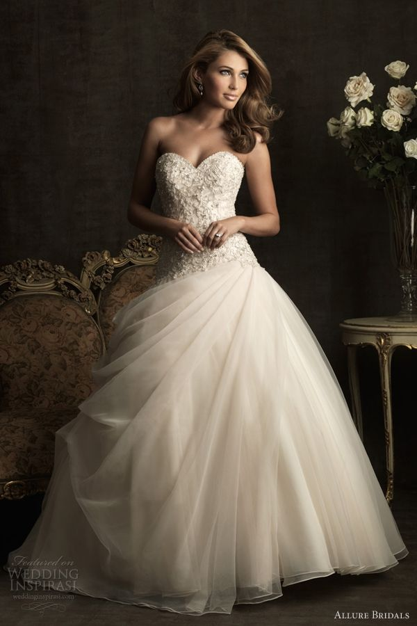 Elegant wedding dresses from Allure Bridals Spring 2012 bridal collection. Above, strapless sweetheart neckline ball gown with draped skirt and bodice adorned with embroidery and Swarovski crystals and features a sweetheart neckline.
