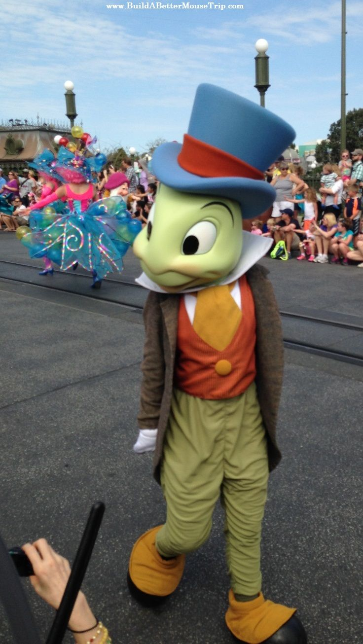 Jiminy Cricket in the Festival of Fantasy Parade in the Magic Kingdom at #Disney World. For Disney World ride closures, crowd warnings, and special event information, see: http://www.buildabettermousetrip.com/monthly-newsletters.php #Disneyworld #MagicKingdom #FestivalofFantasy #WDW #JiminyCricket