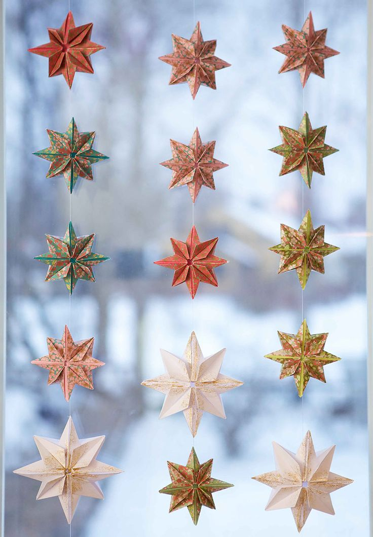 Decorations for Christmas, origami star curtains for the kitchen window. I…