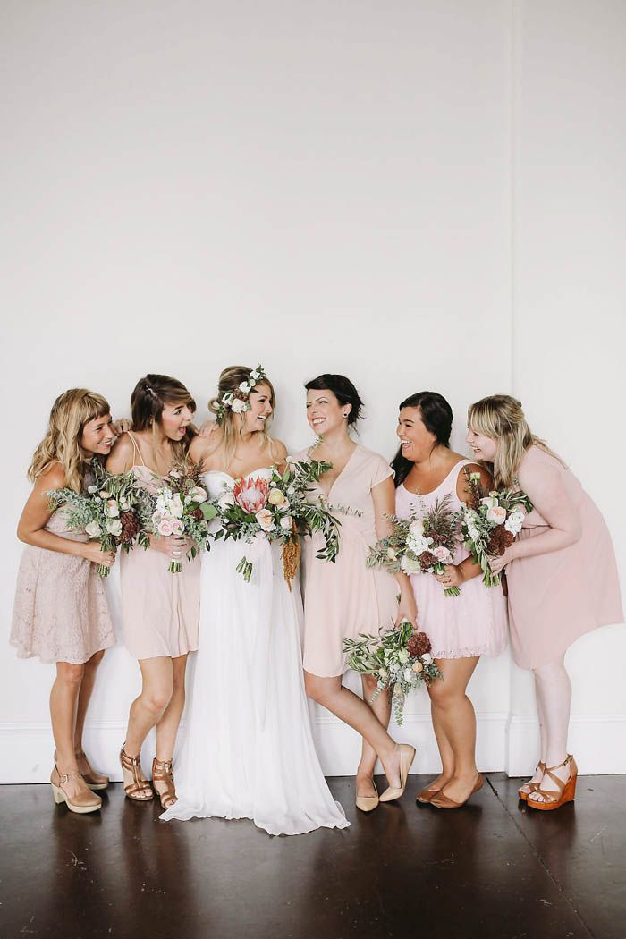 Blush-toned bridesmaid gowns from this bohemian + industrial wedding in South Carolina   | Image by Sanford Creative
