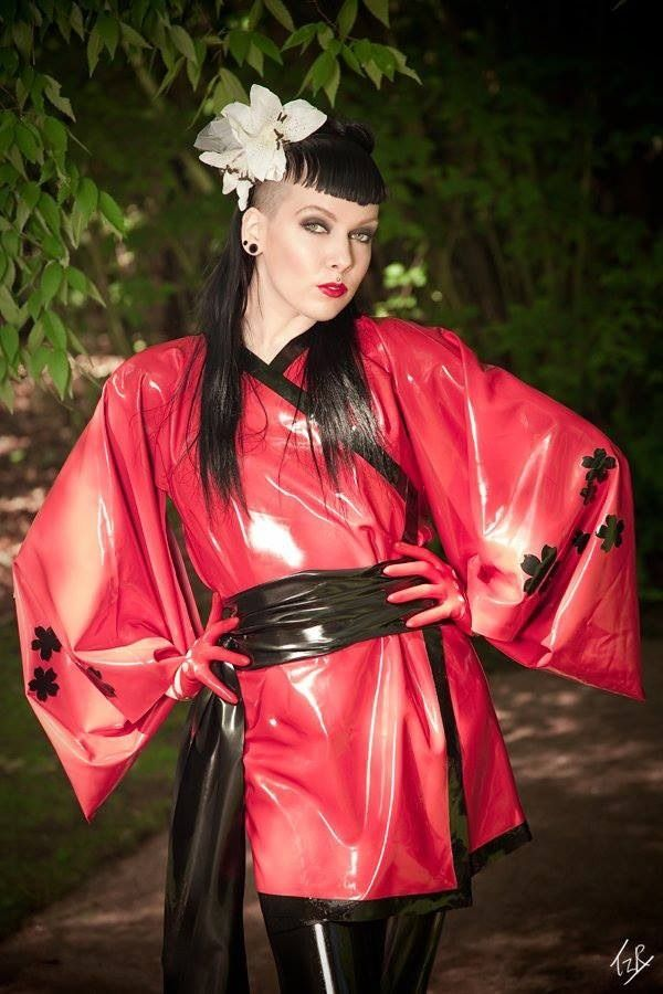 Black and red latex Geisha Girl outfit with matching shorty gloves, contrasting…