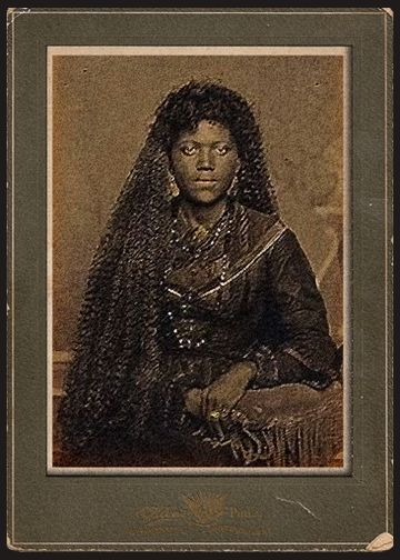 Fictional portrait of a young Marie Laveau - http://fortheloveofallthingsspooky.tumblr.com/post/70479016311/young-marie-laveau-portrait-tintype  More for Marion Warton, the foundress' portion of the Miss Robichaux's Academy  scrapbook.