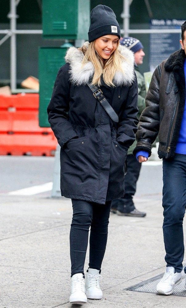 Wear a navy parka and dark blue skinny jeans for both chic and easy-to-wear look. Want to go easy on the shoe front? Opt for a pair of white leather high top sneakers for the day.   Shop this look on Lookastic: https://lookastic.com/women/looks/parka-skinny-jeans-high-top-sneakers/15349   — Black Beanie  — Black Leather Crossbody Bag  — Navy Parka  — Navy Skinny Jeans  — White Leather High Top Sneakers