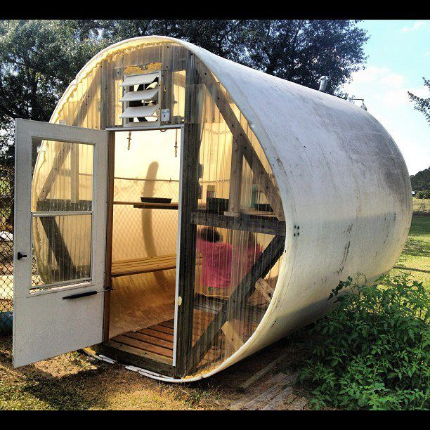 Greenhouse Idea: Reclaimed 13,000 gallon water tank, glass screen door, scrap lumber, found plumbing & electrical supplies, old electric heater, reworked fluorescent lights, exhaust fan... Large enough for household plants, a few okra plants, four hanging tomato plants for the winter in south Alabama. The Peavy Greenhouse: Patricia Vail Peavy
